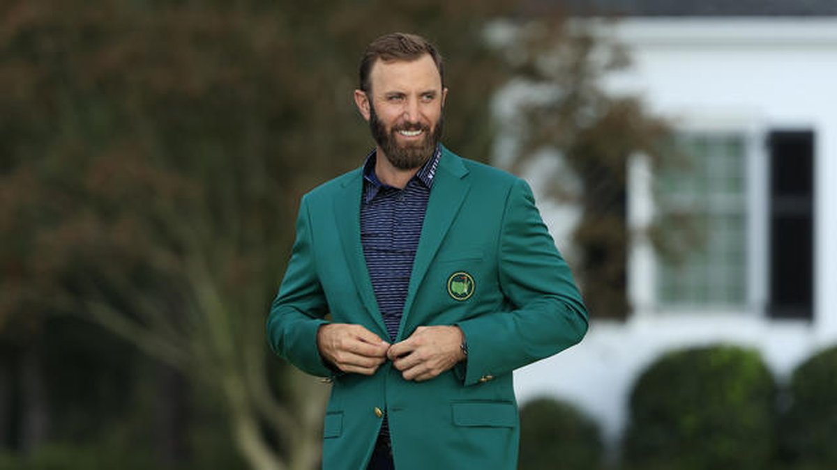 Dustin Johnson tries on the Green Jacket after his 20-under-par victory during Round 4 of the...