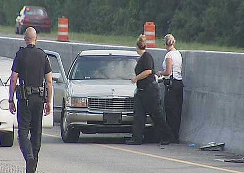 Police officers on scene of a fatal shooting which led to an accident.