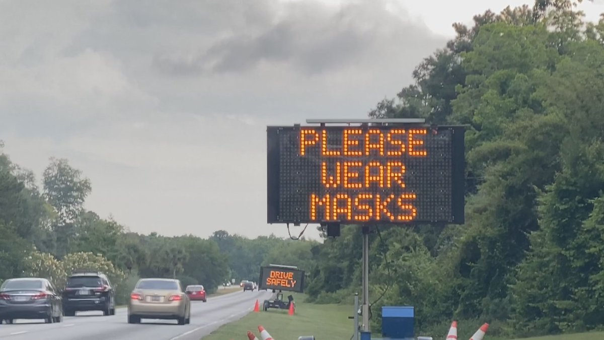 A sign as you get onto Hilton Head Island asks that you social distance and wear a mask.