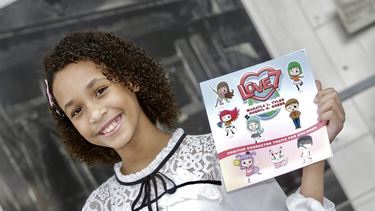 """Makayla Turner created 7 characters with positive personality traits and named her book """"Love 7""""."""