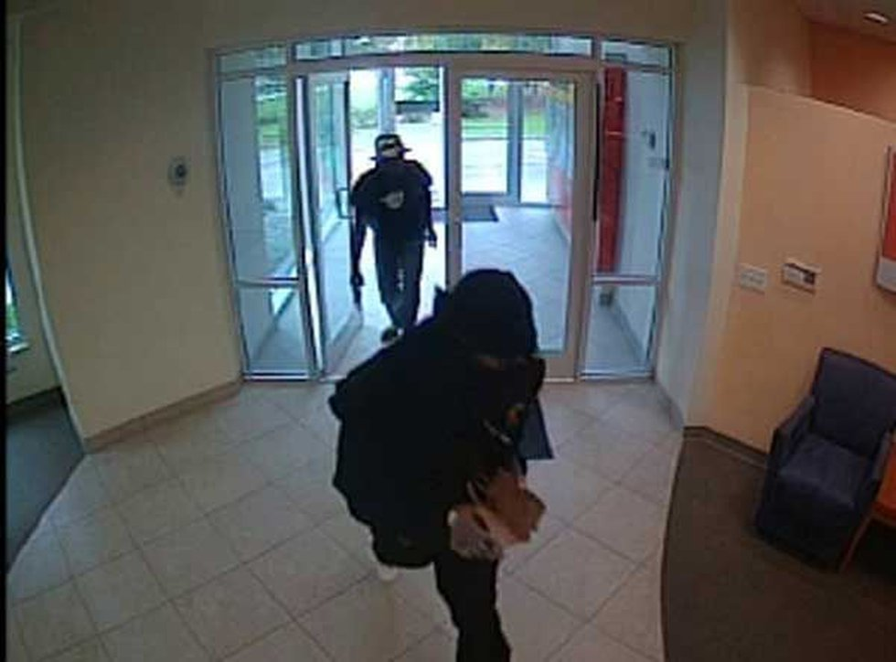 Surveillance pictures of the suspects.
