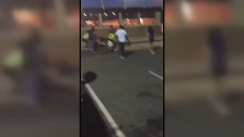 Videos of the incident show two separate groups of students fighting in the parking lot of the...