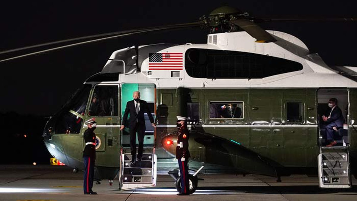 President Joe Biden steps off Marine One before boarding Air Force One on March 19 at Dobbins...