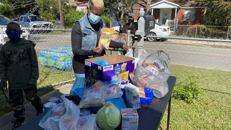 A North Charleston woman organized a food giveaway on Saturday morning to give back to the...