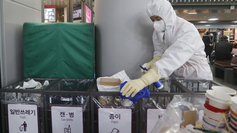 In this Jan. 24, 2020, file photo an employee works to prevent a new coronavirus at Suseo...