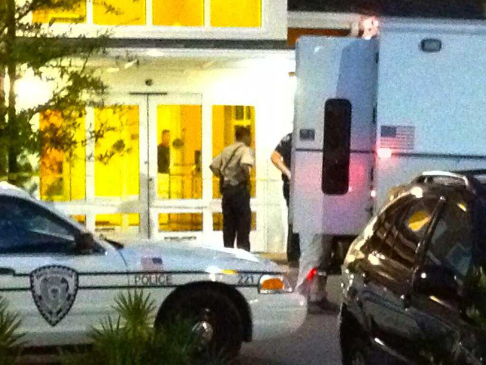 Police say bags discovered in a hotel room where a woman was hiding contained a portable meth...