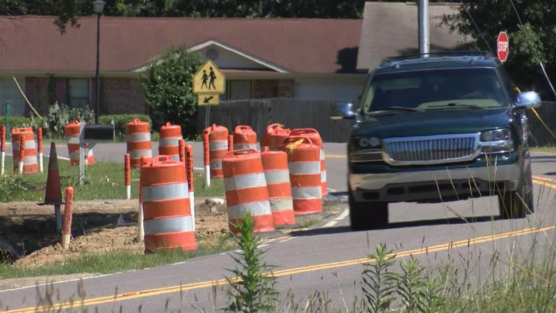 Orange barrels line Royle Road near the intersection of Sangaree Parkway.
