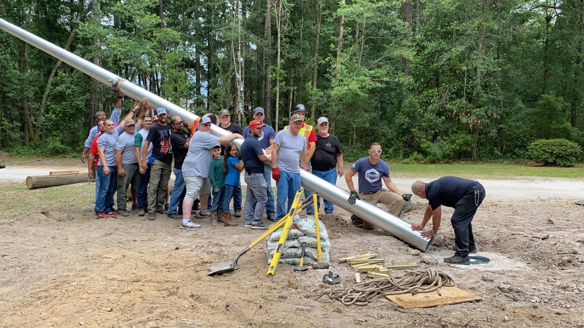 A group of veterans and volunteers helped install a 60-foot-tall flagpole on the OPFOB property...