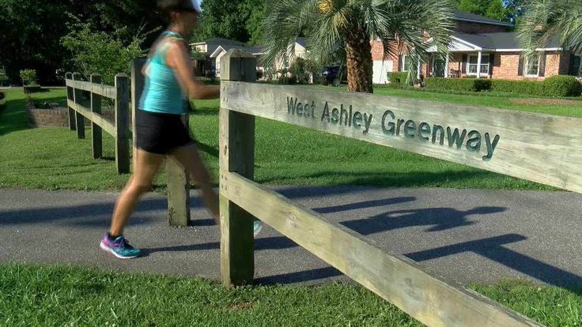 Officers invite members of the community to join them on a bike ride up the West Ashley Greenway.
