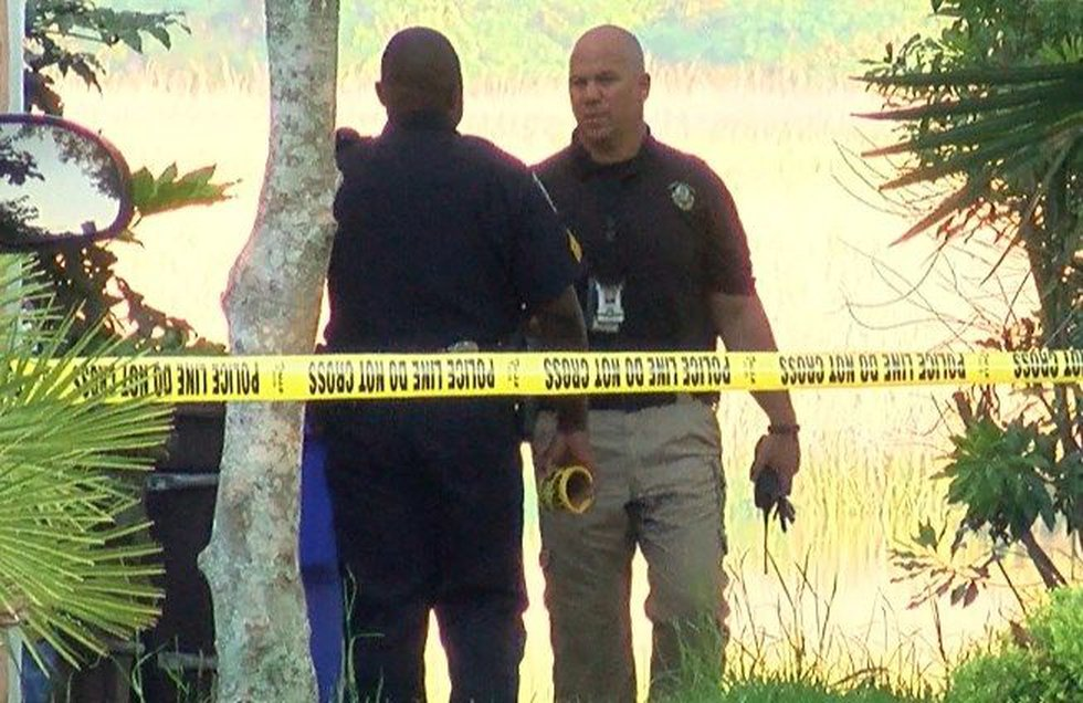 Investigators process the scene at the shooting death of Robert Simpson on May 9, 2017....
