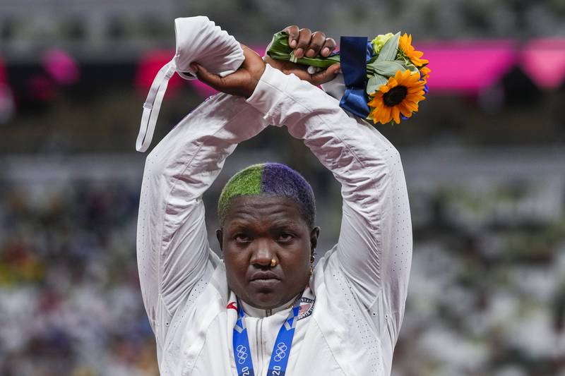 Raven Saunders, of the United States, poses with her silver medal on women's shot put at the...