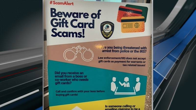 Town employees placed more than a dozen small signs at retail stores, warning people about gift...