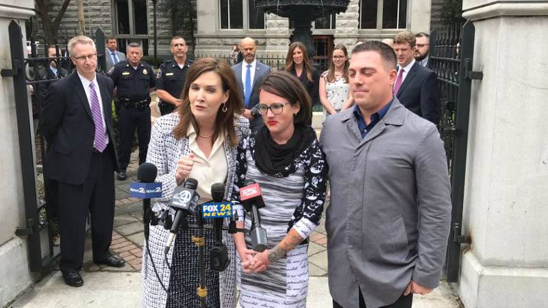 Brittany Todd (center) and her husband Kevin (right) speak after Thomas Evans was sentenced in...