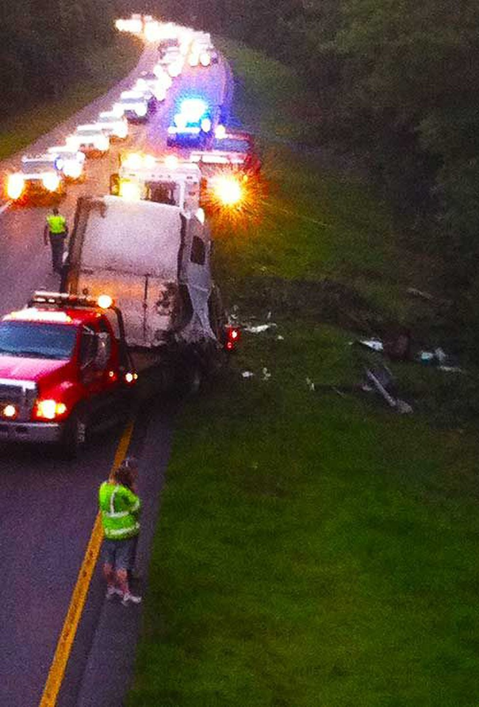 Crews pull out what's left a tractor trailer's cab following an accident in the area of exit...