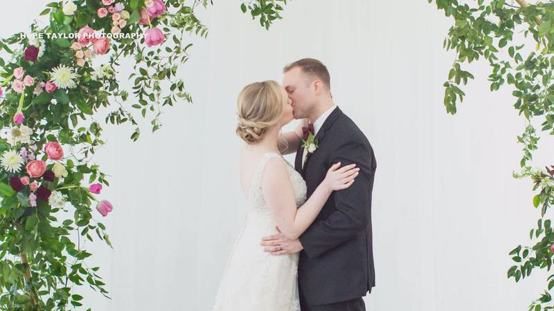 Kelsey and Zach Lucas celebrate their first kiss as husband and wife.