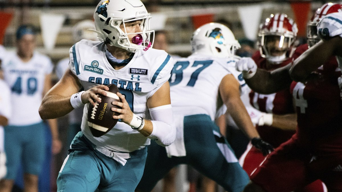 Coastal Carolina quarterback Grayson McCall (10) rolls out to attempt a pass during the first...