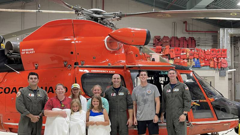 Five people were rescued on Wednesday from Otter Island after their boat drifted off the beach...