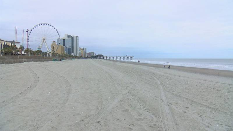 The beach was nearly empty Monday.