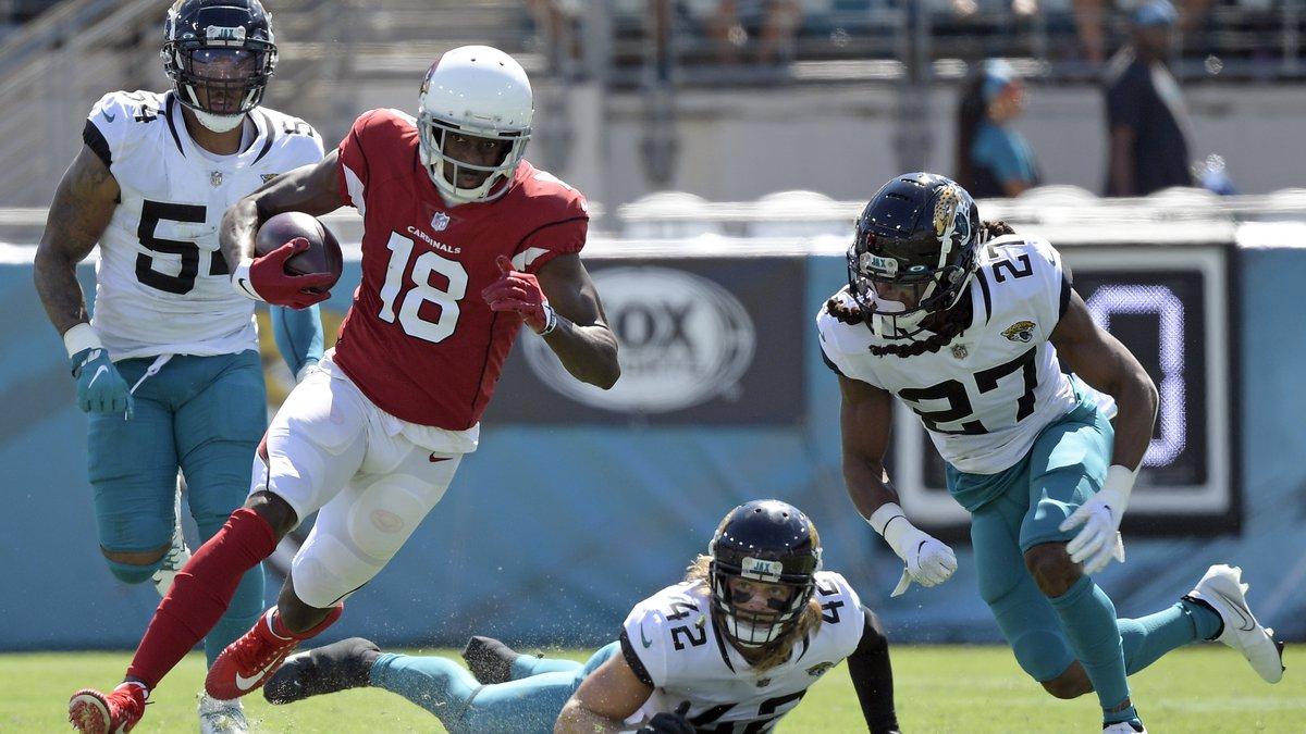 Arizona Cardinals wide receiver A.J. Green runs after a reception past Jacksonville Jaguars...