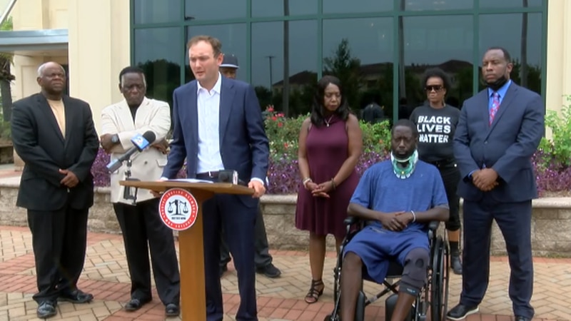 Darian Meggett, along with his lawyer and members of the Racial Justice Network during a news...