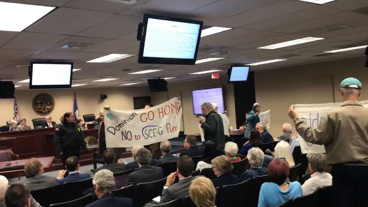 Protesters interrupted Friday's meeting of the Public Service Commission in Columbia after a...