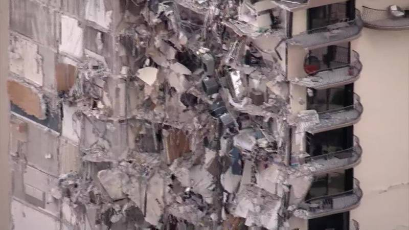 Rescuers look for survivors from a partial building collapse in south Florida.