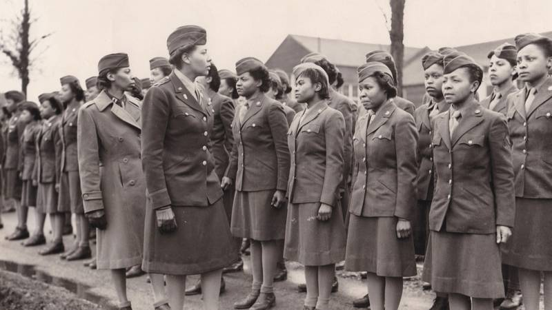 In this photo provided by the U.S. Army Women's Museum, members of the 6888th battalion stand...
