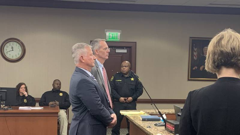 Suspended Florence County Sheriff Kenney Boone entered guilty pleas in a Sumter courtroom...