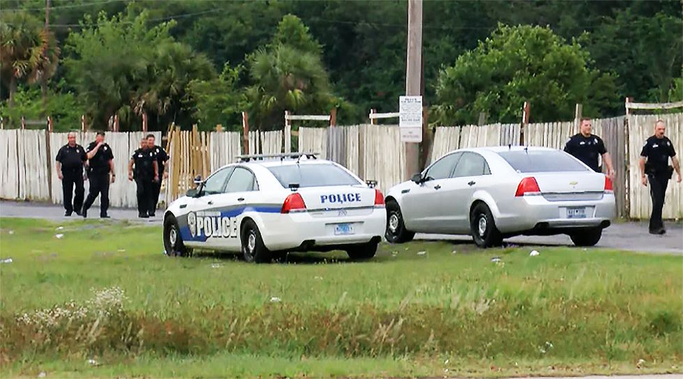 Police officers investigating the shooting in North Charleston Wednesday night.
