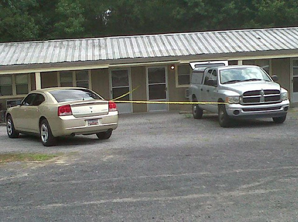 Crime scene tape has been placed across the outside entrances of a few hotel rooms. (Source:...