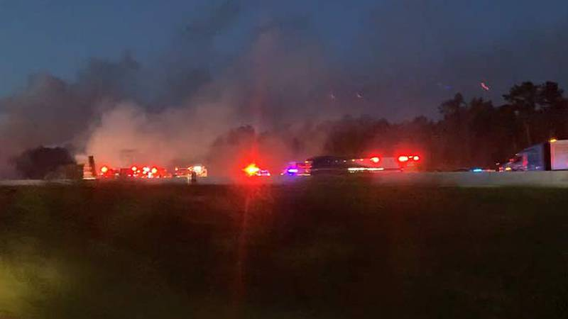 Officials say a fire broke out after a crash at 5:03 a.m. Thursday on I-26 East between Exit...