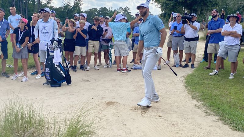 Dustin Johnson shoots from the sand on 12 at the Palmetto Championship at Congaree on Saturday