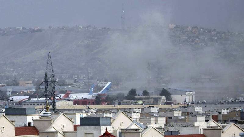 Smoke rises from a deadly explosion outside the airport in Kabul, Afghanistan, Thursday, Aug....