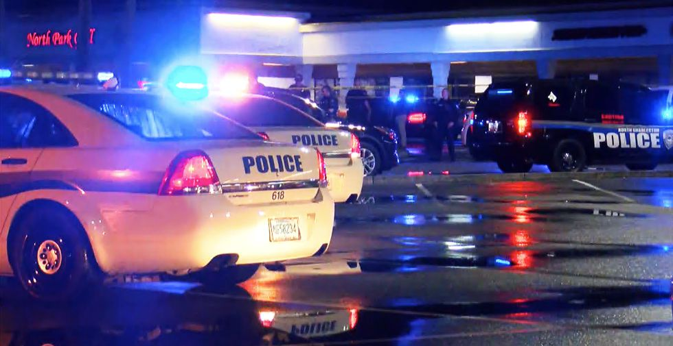 North Charleston police are searching for a killer after a man was shot dead outside a bar...