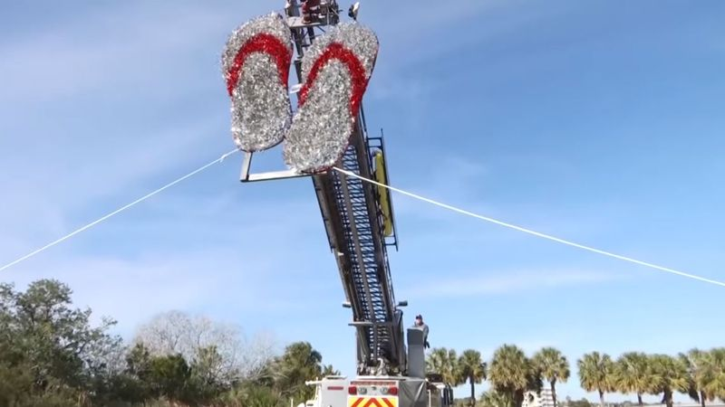 Crews prepare for the annual flip flop drop on Folly Beach