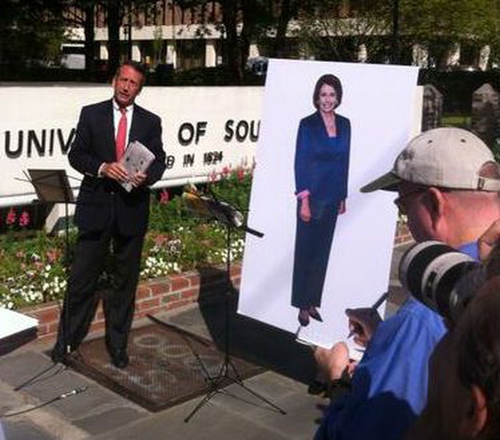 Sanford with the Pelosi poster.