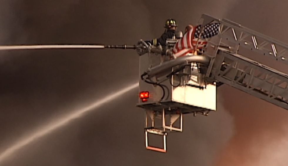 Firefighters work to contain the fire on June 18, 2007. (Source: Live 5)
