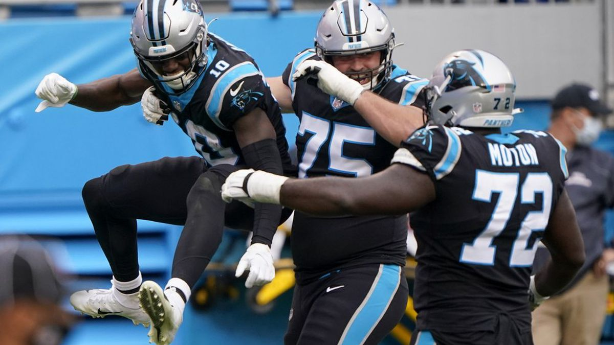 Carolina Panthers wide receiver Curtis Samuel, left, celebrates after scoring with Michael...