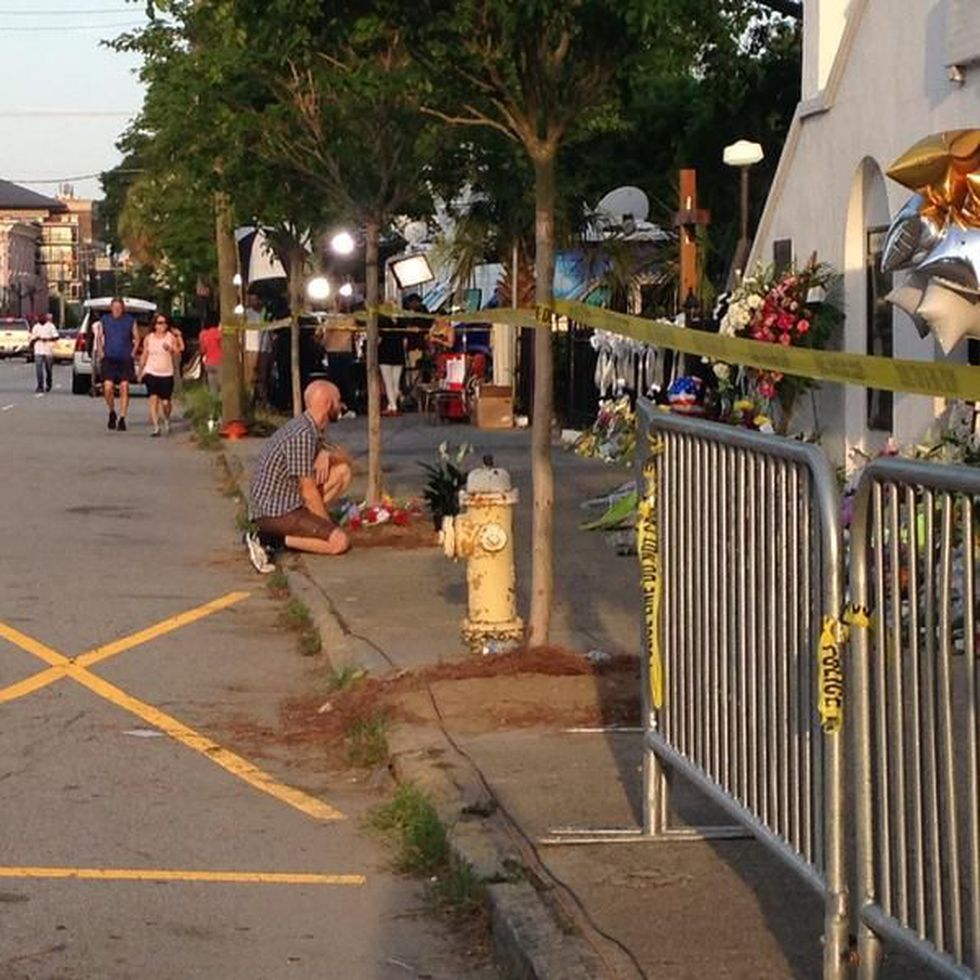 Visitors honor the victims of the shooting. (Photo source: WCSC)