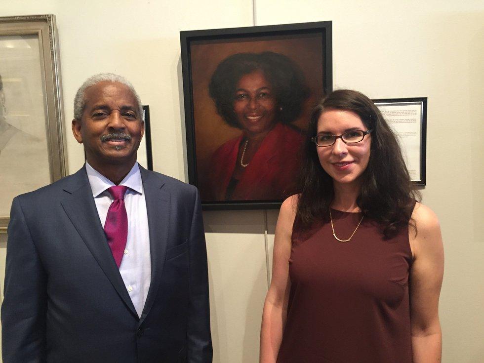 Anthony Thompson, husband of Myra Thompson, poses with artist Stephanie Deshpande.